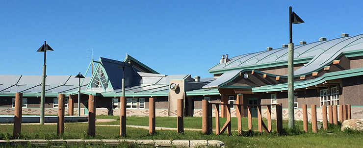 The Peetabeck Academy in the Fort Albany First Nation, with a goose head decorating the main entrance. The community is a recent ECB program participant.